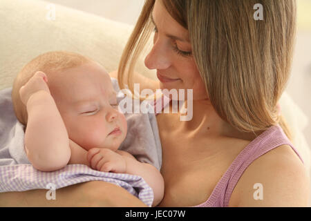 Nut, baby, 4 months, sleep, smile Indoor, girls, people, woman, suture, touch, portrait, curled, happily, hold tenderness, - Stock Photo