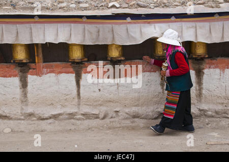 Old woman rotates the prayer drumming in the kingdom Guge, Westtibet, Asia, - Stock Photo