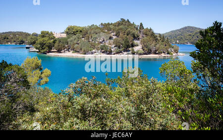 The Benedictine monastery on tiny St Mary's island in Veliko Jezero a sea lake on the island of Mljet in Croatia - Stock Photo