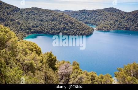 Sea lake of Veliko Jezero and its sea inlet within the island of Mljet  Croatia from the summit of Veliki Skladin - Stock Photo