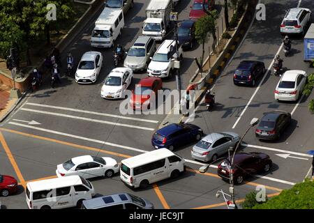 PASIG CITY, PHILIPPINES - JUNE 15, 2017: Private and public vehicles at an intersection in Pasig City, Philippines - Stock Photo