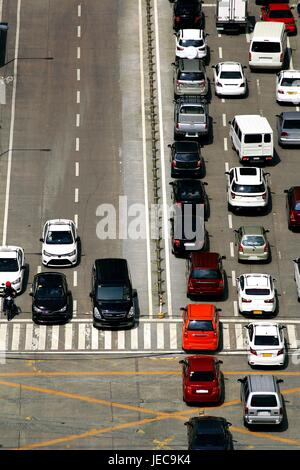Photo of private and public vehicles at an intersection during the rush hour in the morning. - Stock Photo