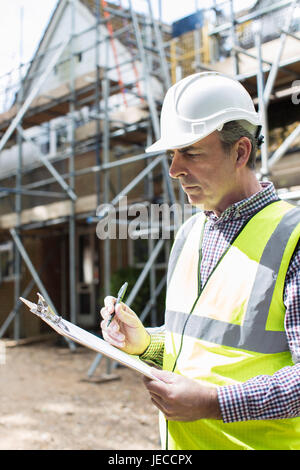 Building Inspector Looking At House Renovation Project - Stock Photo