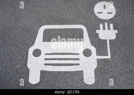Road Sign Showing Charging Point For Electric Cars - Stock Photo