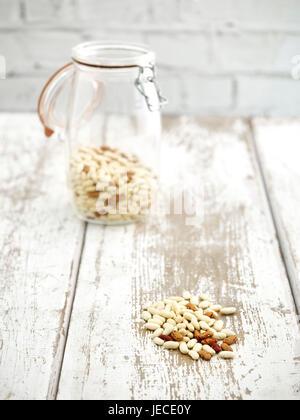 jar of borlotti and Cannellini beans on wooden worktop - Stock Photo