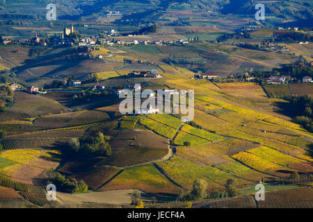 Colorful autumn hills of the langa Piedmont Italy, at the bottom, castle of Serralunga D'alba - Stock Photo