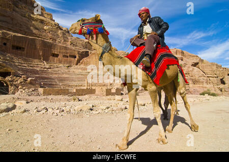 Man rides on a camel, Petra, Jordan, - Stock Photo