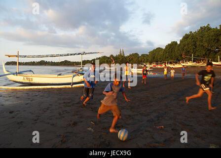 Asia, Indonesia, Bali, Lovina Beach, children play football on the beach, - Stock Photo