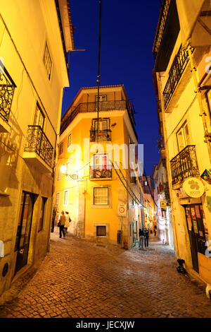 Portugal, Lisbon, Old Town, Alfama, lanes, passers-by, at night, - Stock Photo