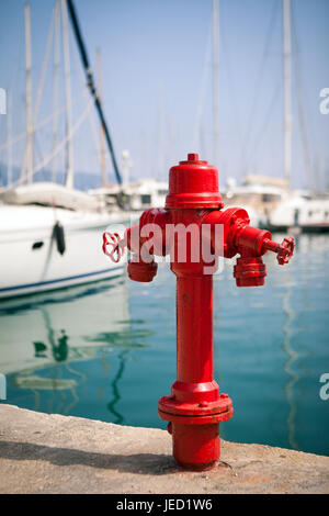 Marine fire hydrant on the quay in front of the yachts, the Mediterranean sea, Greece - Stock Photo