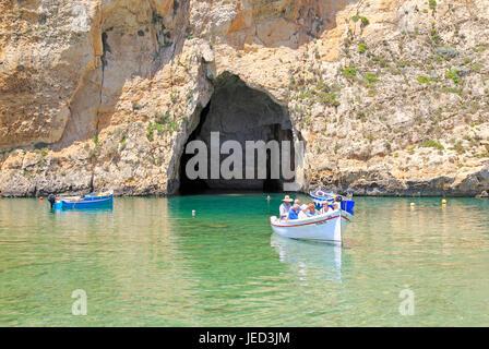 Boat trip at the Inland Sea tourist attraction, Dwerja Bay, island of Gozo, Malta - Stock Photo