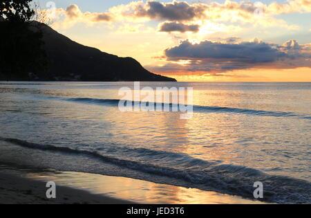 Golden Sunset over deserted Mahe Beach - Stock Photo