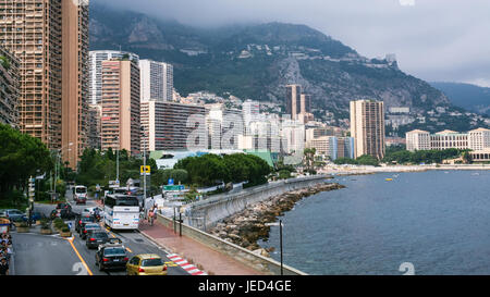 MONACO CITY, MONACO - JULY 6, 2008: tourists and cars on waterfront of Monaco city. Principality of Monaco is sovereign - Stock Photo