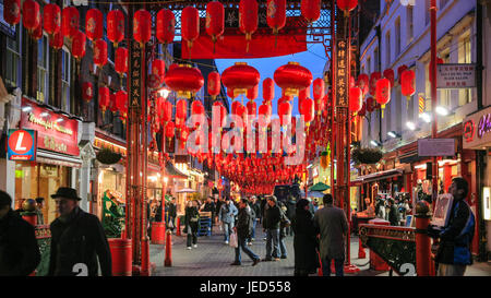 LONDON, UK - JANUARY 20, 2009: people in China Town decorated by Chinese lanterns during Chinese New Year in London. - Stock Photo