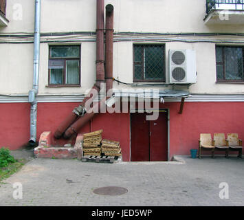 Back entrance to the shop. Pipes for ventilation, air conditioning on the wall - Stock Photo