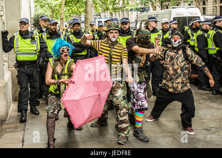 London, UK. 24th June, 2017. Anti-Fascist mime clowns entertain the crowd. The English Defence League march in central - Stock Photo