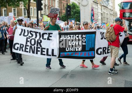 London, UK. 24th June, 2017. Justice for Grenfell at Downing Street, Protesters with a banners at March for homes. - Stock Photo