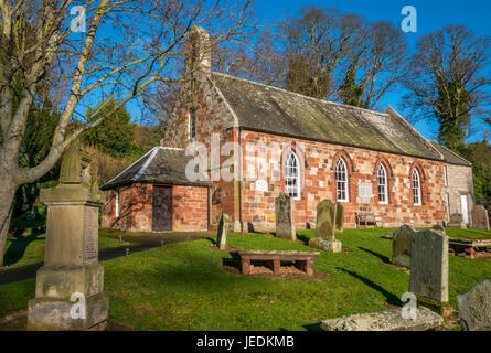 Old picturesque sunlit small sandstone village church and graveyard, Garvald, East Lothian, Scotland, UK - Stock Photo