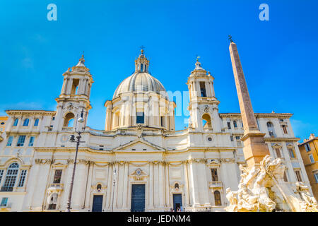 Church Sant Agnese in Agone and Fountain of the four Rivers with Egyptian obelisk on Piazza Navona in Rome, Italy - Stock Photo