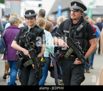 Armed police officers on patrol at the Royal Highland Show, Ingliston, Edinburgh. - Stock Photo