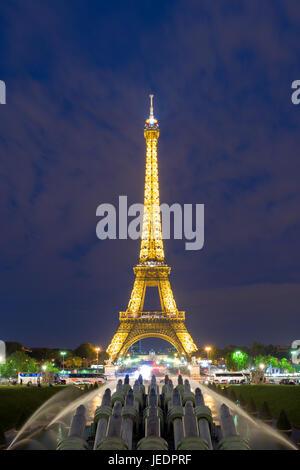 PARIS, FRANCE - May 8, 2016: Beautiful night scene of illuminated Eiffel Tower at dusk, Paris, France. - Stock Photo