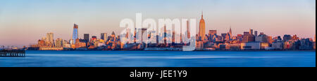 Panoramic view at sunset of Midtown West skyscrapers with the Hudson River. Manhattan, New York City - Stock Photo