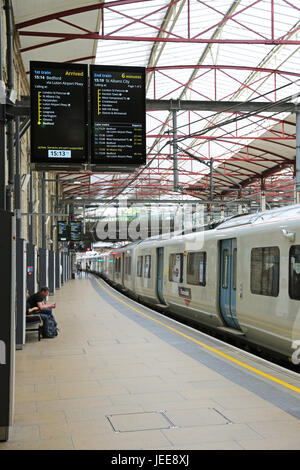 Platform 4 at Farringdon Station, London, UK, Shows old Thameslink series 319 train and new train information display - Stock Photo