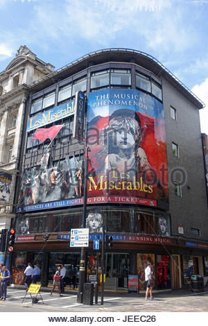 Front view of the Queen's Theatre on Shaftesbury Avenue in London - Stock Photo