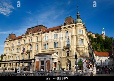 Kresija Building in the Old Town of Ljubljana Slovenia from the Triple Bridge over the Ljubljanica river with Ljubljana - Stock Photo