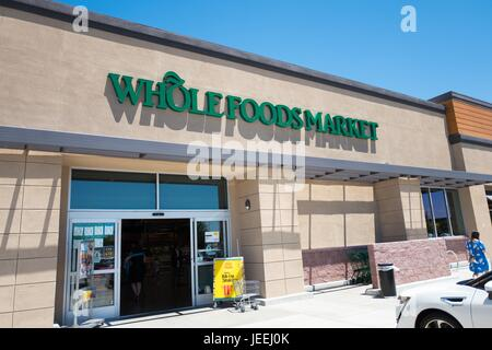 Logo and signage at the Whole Foods Market grocery store in Dublin, California, June 16, 2017. - Stock Photo