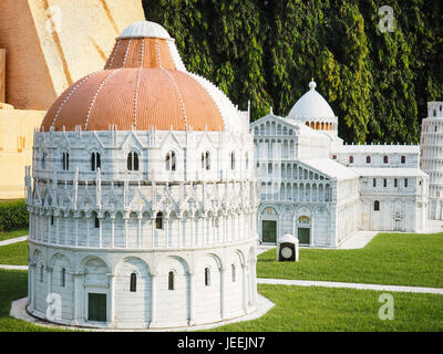 Baptistery (battistero), Pisa Cathedral (duomo) and the Leaning Tower (Torre Pendente) on the Square of Miracles - Stock Photo