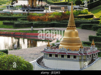 Miniature model of Wat Saket, Golden mountain, thai temple with gold pagoda on the top, popular Bangkok, Thailand - Stock Photo