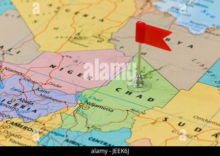 Photo of Chad marked by red flag in holder. Country on African continent. - Stock Photo