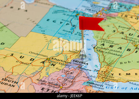 Photo of Eritrea marked by red flag in holder. Country on African continent. - Stock Photo