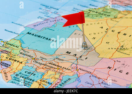 Photo of Mali marked by red flag in holder. Country on African continent. - Stock Photo