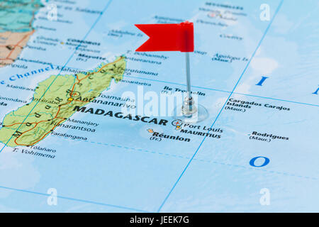 Photo of Mauritius marked by red flag in holder. Country on African continent. - Stock Photo