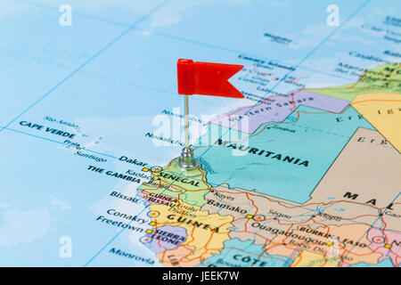 Photo of Senegal marked by red flag in holder. Country on African continent. - Stock Photo