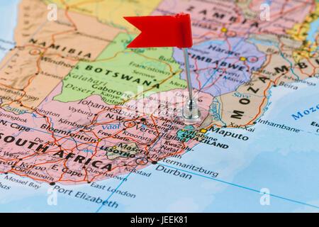 Photo of Swaziland marked by red flag in holder. Country on African continent. - Stock Photo
