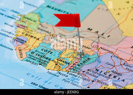 Photo of Togo marked by red flag in holder. Country on African continent. - Stock Photo