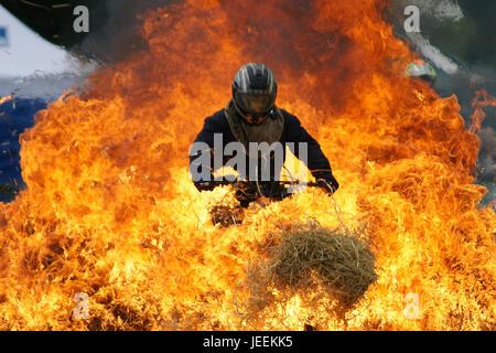 motorbike stunt driver - Stock Photo