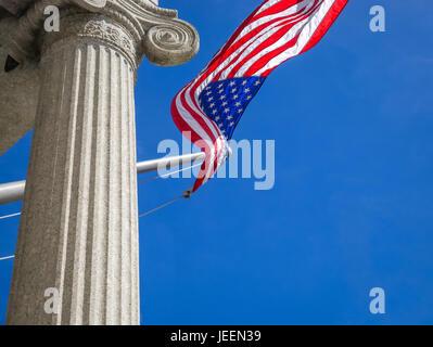 Close up of American flag fluttering against blue sky, Bunker Hill monument, Charlestown, Boston, Massachusetts, - Stock Photo