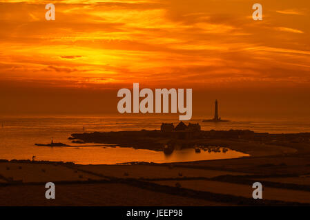 Lighthouse and lifeboat staion in the Goury port near Auderville at the Cap de La Hague at sunset, Cotentin peninsula, - Stock Photo