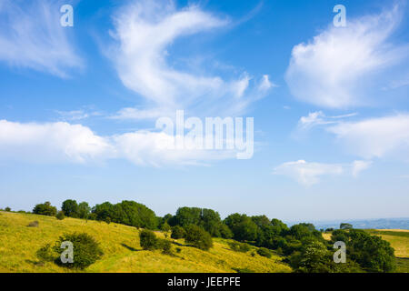 Altocumulus clouds over Deerleap on a summers day in the Mendip Hills, Somerset, England - Stock Photo