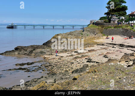 Clevedon pebble beach, North Somerset, with its pier in background - Stock Photo