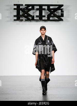 KTZ SS18 catwalk at Strand 180 during London Fashion Week Mens with a male models taking the stage  and producing - Stock Photo