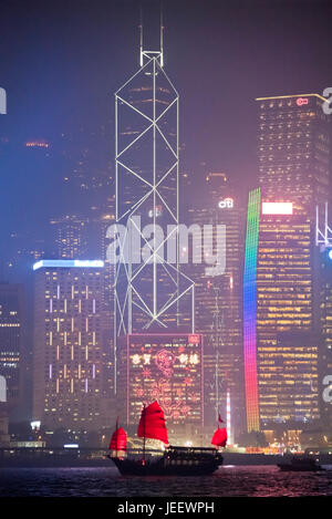 Vertical view of Hong Kong Island in the fog lit up at night, China. - Stock Photo