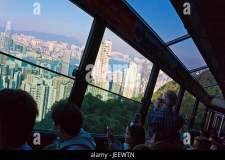 Horizontal view of passengers onboard the Peak tram in Hong Kong, China. - Stock Photo