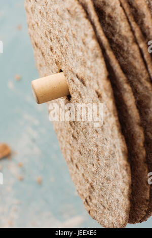 Swedish round crisp bread in close up. Scandinavian food detail. - Stock Photo