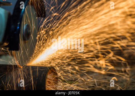 Sparks from cutting metal cutting tool manually. - Stock Photo