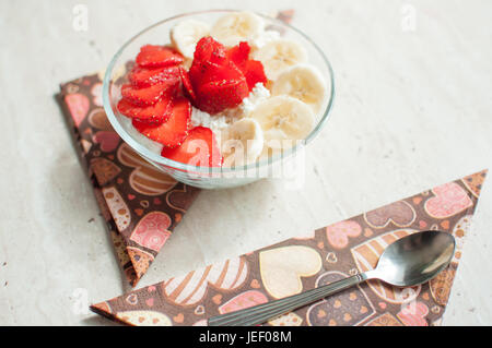 Bowl of cottage cheese with strawberry and banana. Close-up, selective focus. - Stock Photo
